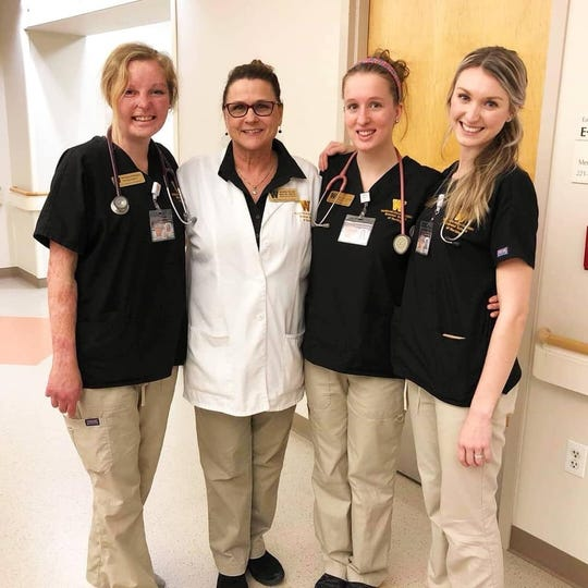 Brianna Bolinger (left) is in the nursing program at Western Michigan University. She is also a baton twirler for the Broncos and a burn survivor and advocate.
