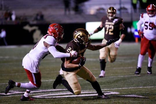 Ball State Cardinals cornerback Antonio Phillips (21) tackles Western Michigan Broncos wide receiver Brandon Hinds (24)on Tuesday, Nov. 5, 2019 at Waldo Stadium in Kalamazoo, Mich.