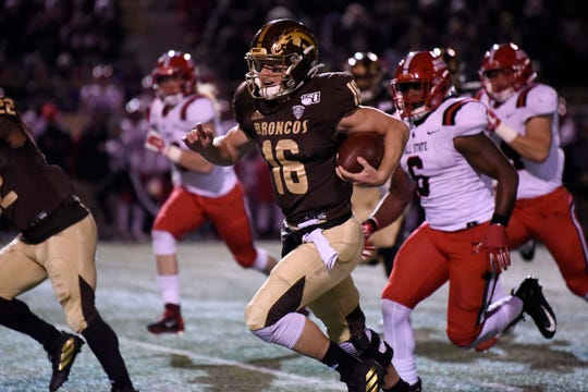 Western Michigan Broncos quarterback Jon Wassink (16) scores a touchdown on Tuesday, Nov. 5, 2019 at Waldo Stadium in Kalamazoo, Mich.