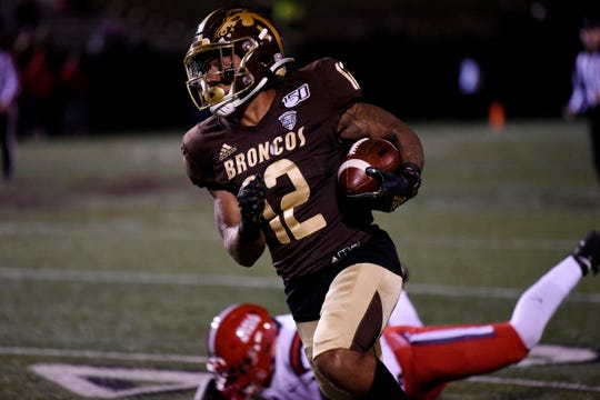 Western Michigan Broncos wide receiver Keith Mixon Jr. (12) scores a touchdown on Tuesday, Nov. 5, 2019 at Waldo Stadium in Kalamazoo, Mich.