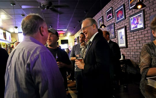 Michael Korchak, who is running for Broome County District Attorney, with supporters at Petersons Tavern in Binghamton.