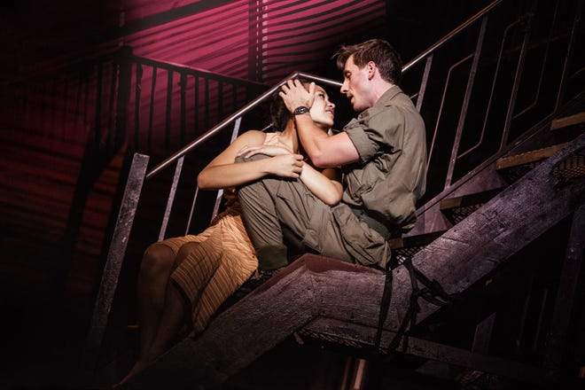 """Emily Bautista (Kim) and Anthony Festa (Chris) sing """"Sun and Moon"""" in the North American Tour of """"Miss Saigon."""""""