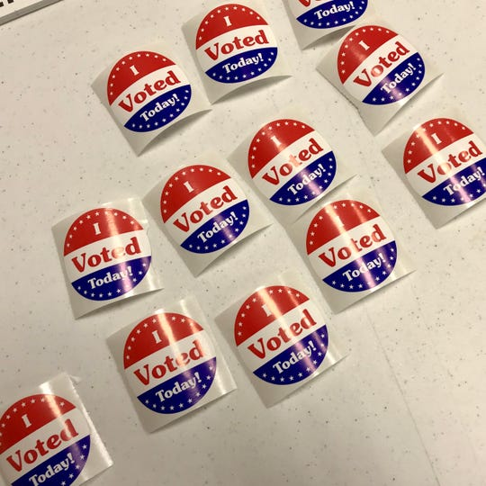 'I voted' stickers await voters Tuesday at the Jewish Community Center in Binghamton.
