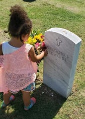 Gregory Edwards' daughter visits his grave