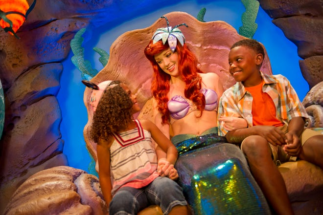 "Tucked into the rocks beyond Prince Eric's Castle, Magic Kingdom guests can continue their journey ""under the sea"" with ""The Little Mermaid"" at Ariel's Grotto. The character greeting location is part of New Fantasyland at Walt Disney World Resort in Lake Buena Vista, Fla. (Kent Phillips, photographer)"