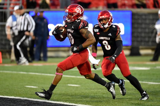 Louisville running back Javian Hawkins  of Cocoa (10) runs in for a touchdown during the second half of a game against Virginia in Louisville, Ky., Saturday, Oct. 26, 2019.