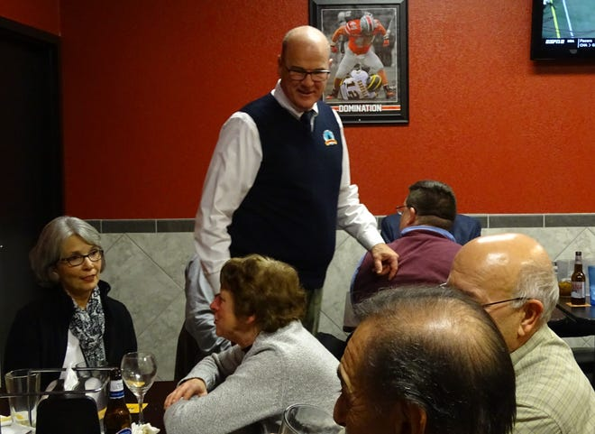 Bucyrus Mayor Jeff Reser celebrates his reelection with friends and supporters Tuesday evening at Baker's Pizza Sports Shack.