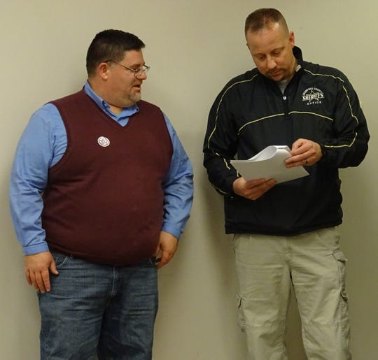 Crawford County Sheriff Scott Kent, right, reviews election results with county prosecutor Matt Crall at the Crawford County Board of Elections on Tuesday.