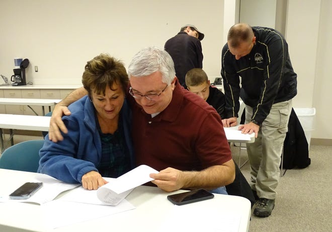 Newly elected Crestline mayor Linda Horning Pitt gets a congratulatory hug from Crestline school board member Jeff Wilhite as results were released Tuesday night at the Crawford County Board of Elections office. Wilhite was reelected to the school board Tuesday.