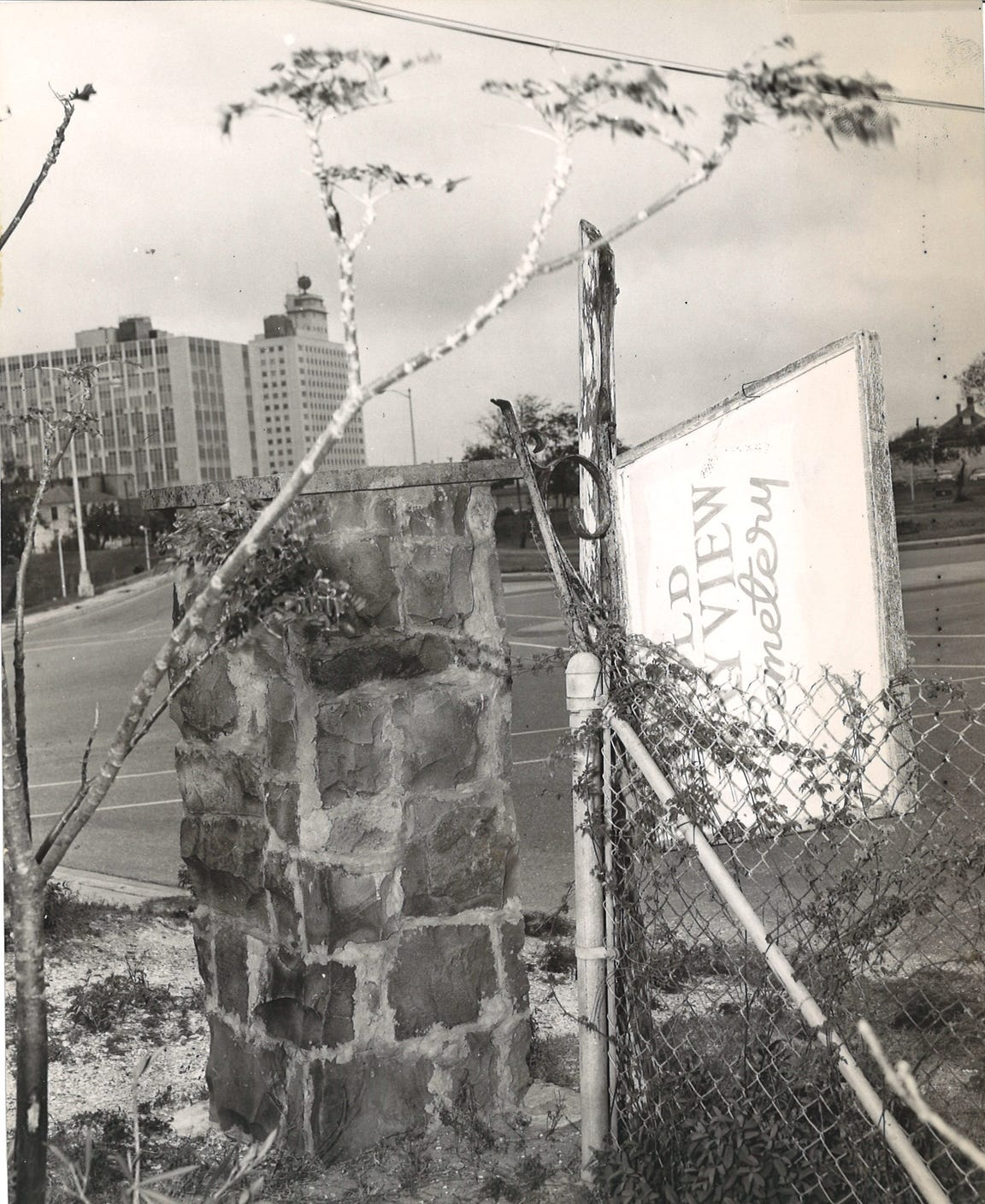 The sign at the entrance of Old Bayview Cemetery near downtown Corpus Christi was knocked loose when this photo was taken in May 1962.