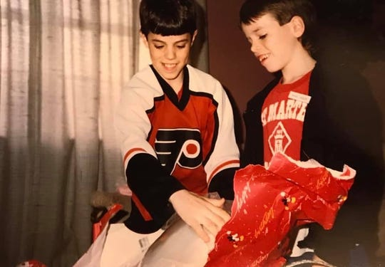 Mark (left) and Michael Jagielski open a gift together in the late 1980s. Michael, who lost his older brother Mark in a hit-and-run accident in 1994, said the Flyers always remind him of Mark, who was a huge fan of the team.