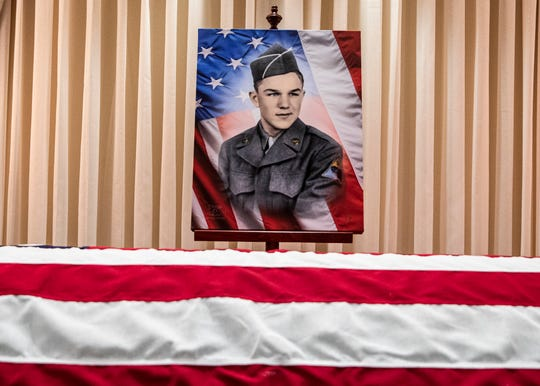 A army portrait of Korean War veteran Robert Bray stands above his remains during a viewing at Smith Moore Ebright Funeral home in Bainbridge Wednesday morning. Bray, a Korean War veteran, was laid to rest after being declared deceased in 1953 by the Army on Nov. 6, 2019.