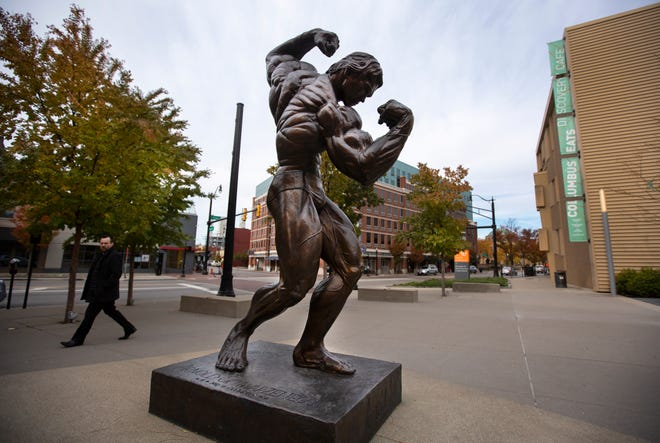 An 8-feet tall bronze statue of Arnold Schwarzenegger stands in front of the Greater Columbus Convention Center in downtown Columbus. The convention center has been home to the Arnold Sports Festival for the past 30 years. It's a bodybuilding and fitness competition and expo.