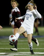 Cincinnati Country Day midfielder Jenna Setters passes against Columbus Academy during their Division III state semifinal at Doug Adams Stadium in Xenia Tuesday, Nov. 5, 2019.