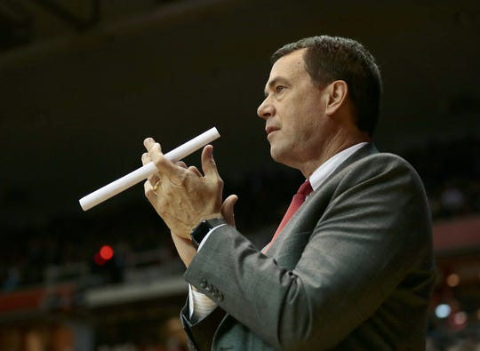Cincinnati athletic director Mike Bohn cheers on his team in the second half of the America Athletic Conference game between the Cincinnati Bearcats and the Houston Cougars at UC's Fifth Third Arena in Cincinnati on Thursday, March 2, 2017. The Bearcats beat the Cougars, 65-27, to finish the regular season undefeated at home. The Bearcats will return to Fifth Third Arena in 2018 after playing a season a Northern Kentucky University's BB&T Arena.