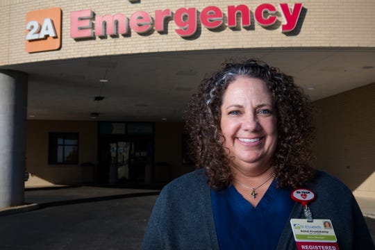 Ashel Kruetzkamp, St. Elizabeth Hospital nurse and emergency department director, stands outside the St. Elizabeth-Edgewood emergency entrance.