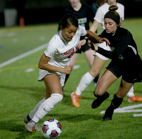 Lakota West player Sydney Jones battles Simone Rivard-Roberts of Dublin Coffman for the ball during their state semifinal match Tuesday, Nov. 5, 2019.