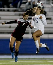 Cincinnati Country Day forward Lawson Renie plays a header against Columbus Academy defender Sarah Neltner during their Division III state semifinal at Doug Adams Stadium in Xenia Tuesday, Nov. 5, 2019.