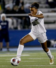 Cincinnati Country Day midfielder Jada Moorman moves the ball up the pitch against Columbus Academy during their Division III state semifinal at Doug Adams Stadium in Xenia Tuesday, Nov. 5, 2019.