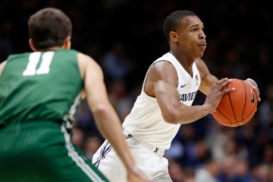 Xavier Musketeers guard Dahmir Bishop (2) throws a pass in the first half of NCAA basketball game between the Xavier Musketeers and the Jacksonville Dolphins at the Cintas Center in Cincinnati on Tuesday, Nov. 5, 2019.
