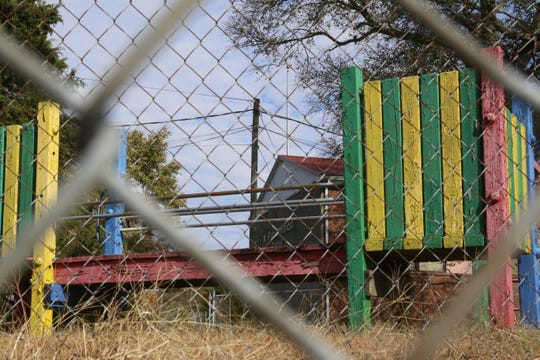 The Lettie Kendall community center building, now proposed to be turned into an adult education center, sits behind a chain link fence and some aging playground equipment.