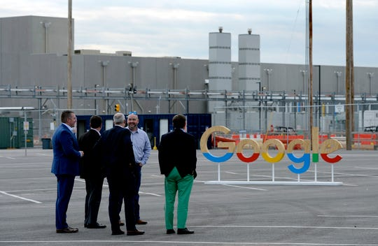 People wait in front of the Google's technical infrastructure buildings before the Montgomery County Data Center's opening ceremony on Wednesday.