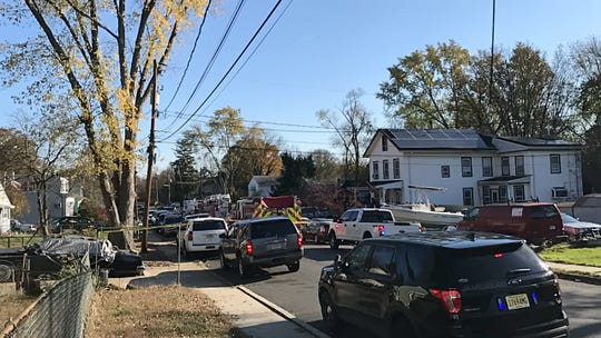 The scene in Jamesburg following a house fire in which two people apparently died
