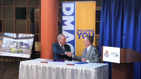Des Moines Area Community College President Rob Denson and University of Northern Iowa President Mark Nook signed a 2+2 agreement Wednesday.
