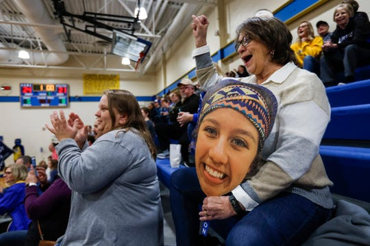 Olivia Cramer's mother, Megan Cramer, left, and grandmother Darla Cramer cheer for her during a district quarterfinal between Lawton and Marcellus at Lawton High School in Lawton, Tuesday, Nov. 5, 2019.