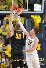 Jon Teske defends the Hunter Seacat of Appalachian State in the second half of Tuesday in Ann Arbor.