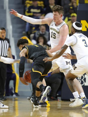Michigan Wolverines center Jon Teske defends Appalachian State Mountaineers guard Justin Forrest during the first half Tuesday, November 5, 2019 at Crisler Center.