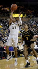 Eli Brooks drives against Appalachian State's Kendall Lewis during the first half Tuesday at Crisler Center.