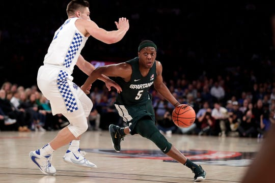 Michigan State guard Cassius Winston drives to the basket past Kentucky forward Nate Sestina during the first half Tuesday, Nov. 5, 2019, in New York.