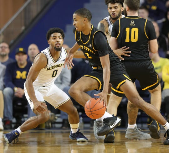 Michigan Wolverines guard David DeJulius defends Appalachian State Mountaineers forward Kendall Lewis during the second half Tuesday, November 5, 2019 at Crisler Center.