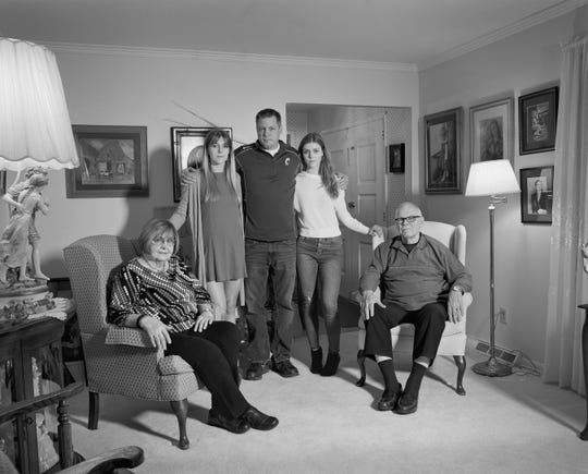 David Green, UAW Local 1112, President, in his parents' living room with his daughters Alison and Cate, and parents Elaine and Roger, (24 years in at GM Lordstown Complex, Chassis three), Girard, OH, 2019.