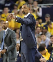 Juwan Howard watches the action against the Appalachian state.