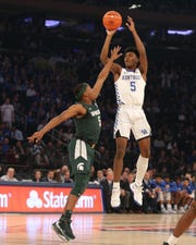 Nov 5, 2019; New York, NY, USA; Kentucky Wildcats guard Immanuel Quickley (5) shoots over Michigan State Spartans guard Cassius Winston (5) during the first half at Madison Square Garden, Nov. 5, 2019.