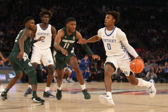 Nov 5, 2019; New York, NY, USA; Kentucky Wildcats guard Ashton Hagans (0) drives the ball against Michigan State Spartans forward Aaron Henry (11) during the first half at Madison Square Garden, Nov. 5, 2019.