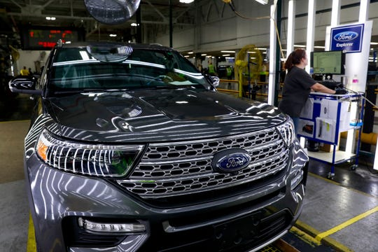 Assembly line hands work on the Explorer SUV line at Ford Motor Co.'s Chicago Assembly Plant.