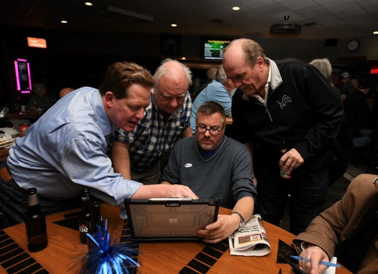 (From left) Royal Oak city commission candidate Randy LeVasseur monitors election results with supporters Chuck Semchena, David Roznowski, and Mike Skinner at the Elks Lodge #34 in Royal Oak, November 5, 2019. LeVasseur won his reelection bid.