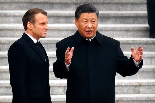 French President Emmanuel Macron, left, listens as Chinese President Xi Jinping talks during a welcome ceremony at the Great Hall of the People in Beijing, Wednesday, Nov. 6, 2019.