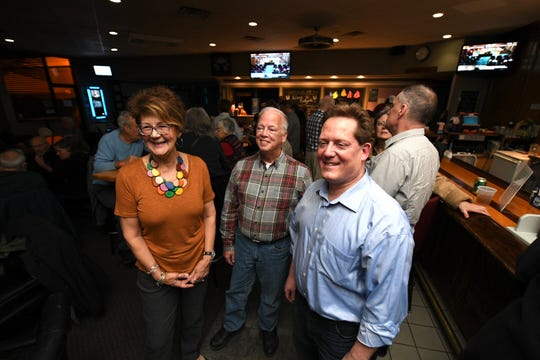 (From left) Royal Oak city commission candidates Pamela Lindell, Tom Hallock, and Randy LeVasseur pose for a photo while monitoring election results at the Elks Lodge #34 in Royal Oak, November 5, 2019.