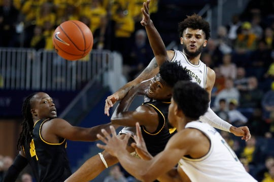 Michigan forward Isaiah Livers passes the ball as Appalachian State guard Adrian Delph (20) defends during the second half.