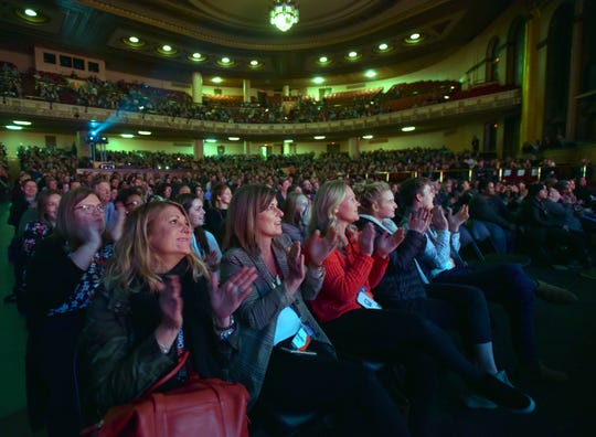 TEDxDetroit attendees clap for voice actor Rob Paulsen inside the Masonic Temple Theater.