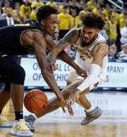 Junior forward Isaiah Livers, right, committed five of Michigan's 17 turnovers against Appalachian State.