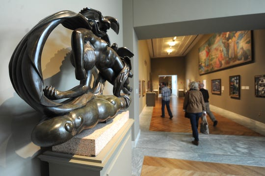 Visitors admire works of art on display at the Detroit Institute of Arts. Foreground: Bronze sculpture Moods of the Evening.