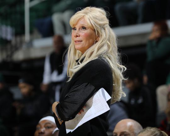 Michigan State women's coach Suzy Merchant looks on during the opening win over Eastern Michigan.