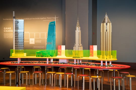 "The Art Deco, iconic Chrysler Building in New York City is the third model from the left, part of ""Towers of Tomorrow with LEGO Bricks"" at the Henry Ford Museum."