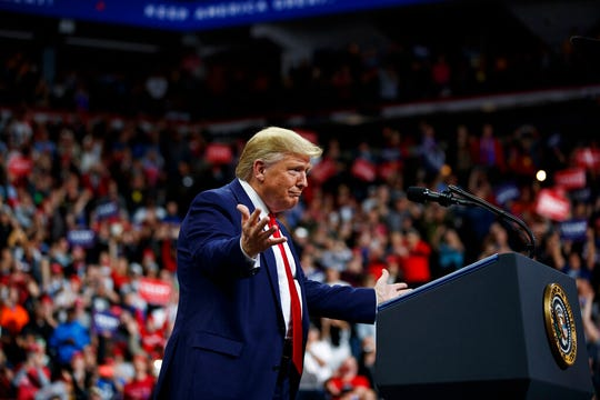 President Donald Trump arrives to speak at a campaign rally at the Target Center, Thursday, Oct. 10, 2019, in Minneapolis.