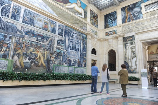 Visitors view Diego Rivera's Detroit Industry Murals at the DIA.